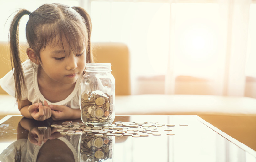 The NAFCU Journal - The Best Indirect Growth Strategy - Little girl with coin jar