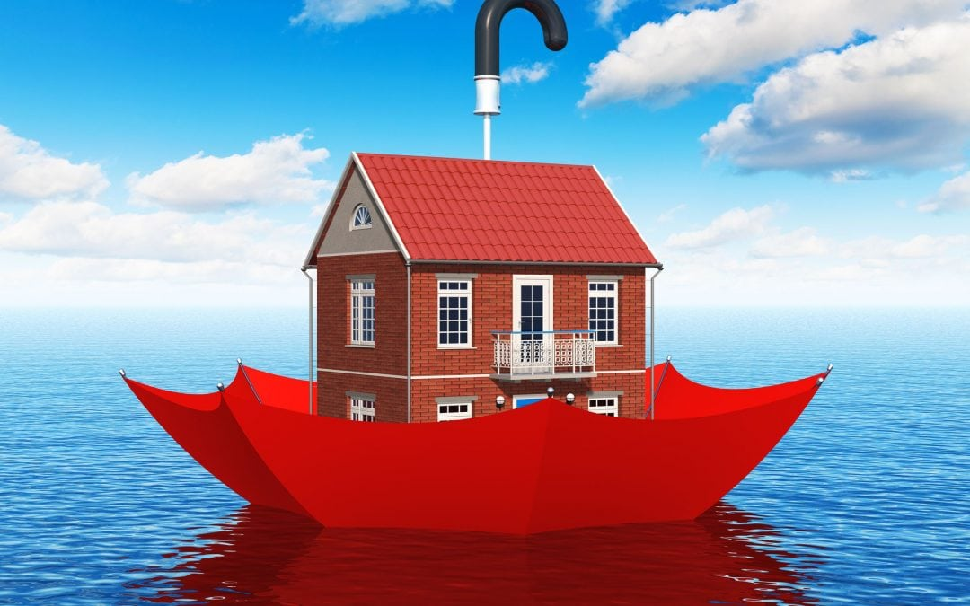 Cartoon of a house floating down a river in an umbrella, meant to imply that flood insurance is keeping it dry.
