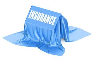"An ""insurance blanket"" is thrown over a house, simulating force-placed insurance."